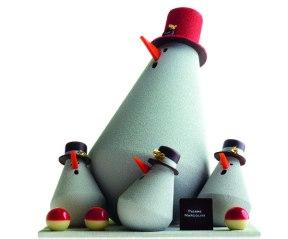 Pierre Marcolini - Un «sapin de Noël» fait de bonshommes de neige en chocolat noir et garni de pralinés et gourmandises 125€