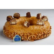 Café de la Paix - Composée d'une crème d'amandes et frangipane, d'éclats de chocolat et de caramel, et d'un perlé d'oranges, cette création est royale ! 43€/8pers.